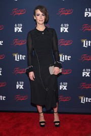 Sarah Paulson styled her look with a taupe suede clutch by M2Malletier.