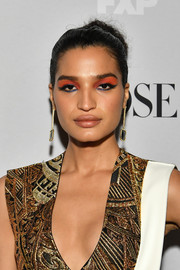 Indya Moore wore her hair in a loose bun at the premiere of 'Pose' season 2.