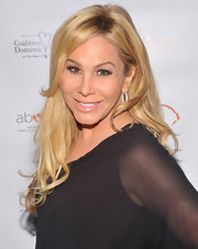 Adrienne Maloof let her hair fall in soft waves at the 2011 About Face benefit.