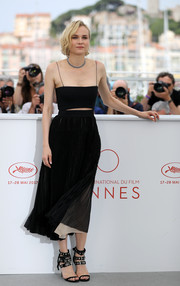 Diane Kruger slipped into a black Boss midi dress with spaghetti straps and a slashed midriff for the Cannes Film Festival photocall for 'In the Fade.'