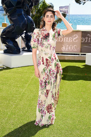 Miriam Leone was conservative yet cute in a floral maxi dress while attending the Cannes photocall for 'Fai Bei Sogni.'