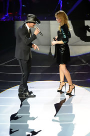 Faith Hill took the stage in Las Vegas wearing strappy black and gold heels.