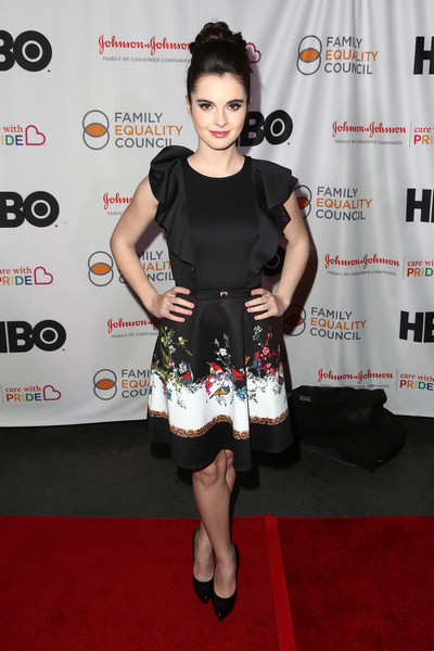 Vanessa Marano was sweet and ladylike in a Ted Baker dress with a ruffled bodice and a printed skirt at the 2018 Impact Awards.