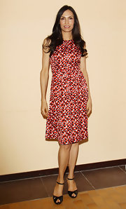 Famke Janssen opted for a more casual look at the Busto Arsizio Film Festival in this busy print dress.