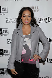 La La Anthony looked tough-chic in her gray leather jacket at the Famous Stars and Straps 10th anniversary party.