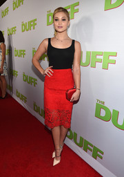 For her bag, Olivia Holt picked a geometric red satin clutch.