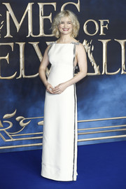 Alison Sudol looked angelic in a white Miu Miu column dress with silver trim at the UK premiere of 'Fantastic Beasts: The Crimes of Grindelwald.'