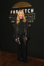 Rachel Zoe worked a sparkly '70s-chic pantsuit from her own label at the Gianni Versace Archive celebration.