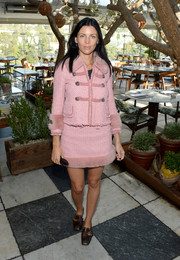 Liberty Ross attended the Fashion Awards 2016 official nominees announcement wearing a pink tweed skirt suit with a fur collar, hem, and cuffs.