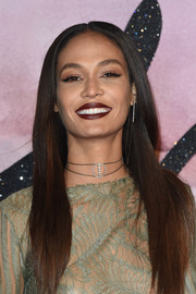 For her beauty look, Joan Smalls went bold with a dark red lip.