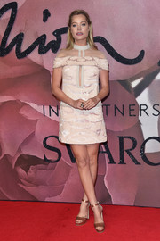 Laura Whitmore went retro at the Fashion Awards 2016 in a nude mini dress with a sheer neckline.