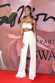 Jourdan Dunn matched her top with white bell-bottoms, also by Brandon Maxwell.