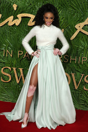 Winnie Harlow paired her sweater with a mint-green ball skirt for a more glamorous finish.