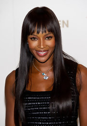 Naomi Campbell styled her hair in a sleek straight cut with blunt bangs at the Fashion for relief event.