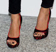 Ana Araujo attended the Fashion for Relief wearing a chic pair of red and black lace-overlay peep-toes.