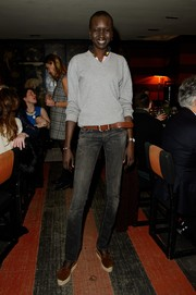 Alek Wek went for a boyish vibe in a gray V-neck sweater with scrunched-up sleeves when she went to Christie's Fashion Illustration Gallery.