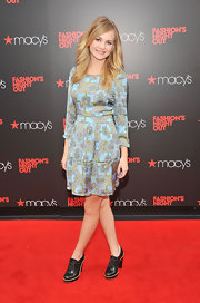 Britt Robertson took a risk by pairing black brogues with her feminine dress.