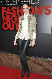Coco Rocha topped off her chic ensemble at FNO in NYC with black leather over-the-knee boots.