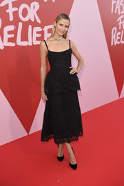 Natasha Poly went the ladylike route in a black lace peplum dress by Ulyana Sergeenko for her Fashion for Relief red carpet look.