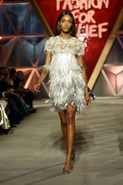 Jourdan Dunn looked sweet in this feather-and-flower-festooned confection by Ralph & Russo on the Fashion for Relief runway.