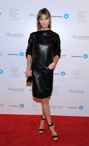 Karlie Kloss attended the Fashion World of Jean Paul Gaultier reception wearing a fierce black leather dress by, who else, Jean Paul Gaultier.
