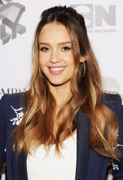 Jessica Alba attended the Fast Company Innovation Festival wearing a boho half-up hairstyle.