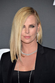 Charlize Theron sported a sleek, elegant side-parted style at the Paris premiere of 'Fast & Furious 8.'