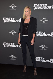 Charlize Theron kept it sleek and sophisticated in a black Dior pantsuit at the Paris premiere of 'Fast & Furious 8.'
