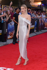 Vanessa Kirby complemented her frock with silver ankle-strap sandals.