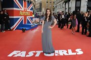 Lily James went gray in this elegant knit gown at the 'Fast Girls' premiere in London.