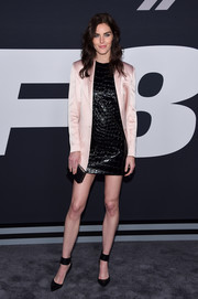Hilary Rhoda attended the premiere of 'The Fate of the Furious' rocking a croc-effect faux-patent LBD by Miu Miu.