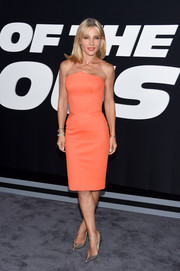 Elsa Pataky kept it minimal yet sophisticated in a strapless orange Zac Posen dress with a peaked neckline at the premiere of 'The Fate of the Furious.'