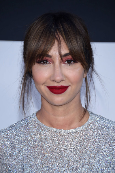 Jackie Cruz styled her hair into a loose, slightly messy chignon for the premiere of 'The Fate of the Furious.'