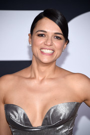 Michelle Rodriguez opted for a tight, side-parted braid when she attended the premiere of 'The Fate of the Furious.'