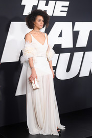 Nathalie Emmanuel looked like an angel in a white Lanvin gown with a matching feathered shrug that the actress paired with a bracelet by Alexis Bittar and ring by Eva Fehren during the premiere of 'The Fate of the Furious.'