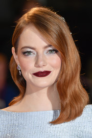 Emma Stone looked vintage-glam with her half-pinned waves at the UK premiere of 'The Favourite.'