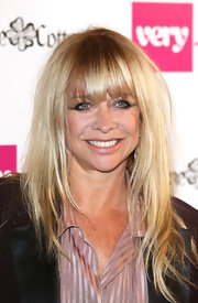 Jo Wood attended a fashion launch in London with her blonde hair styled with body and a little texture.
