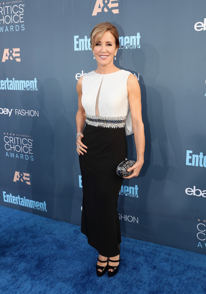 Felicity Huffman Metallic Clutch [red carpet,flooring,shoulder,fashion model,fashion,carpet,joint,electric blue,formal wear,red carpet,premiere,felicity huffman,santa monica,california,barker hangar,annual critics choice awards]