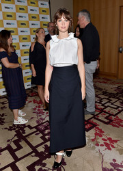 Felicity Jones continued the conservative vibe with an ankle-length skirt.
