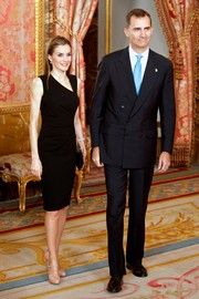 Princess Letizia exuded modern elegance in a little black dress with an asymmetrical neckline during a Principe de Asturias Foundation meeting.