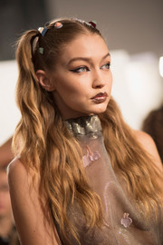 Gigi Hadid looked youthful with her half-up pigtails while getting ready to walk the Fendi runway.