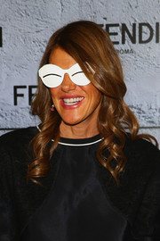 Anna dello Russo looked very girly with her spiral curls during the Fendi fashion show.