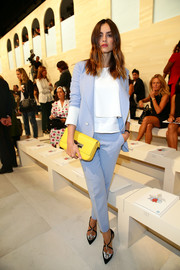 Kasia Smutniak's bright yellow leather clutch made a stylish contrast to her blue suit.