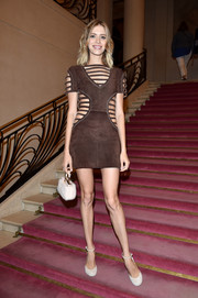 Elena Perminova flashed lots of flesh at the Fendi Couture show in a brown cage dress from the brand.