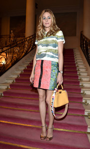 Olivia Palermo made a colorful appearance at the Fendi Couture show in a green, blue, and white sequined T-shirt.