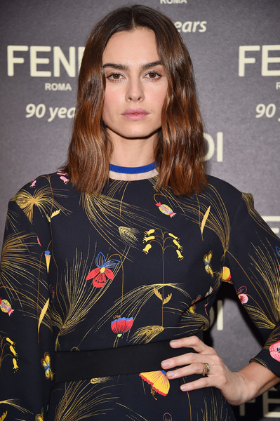 Kasia Smutniak wore her hair down to her shoulders in a wavy, center-parted style during the Fendi Roma 90th anniversary cocktail.