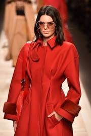 Kendall Jenner looked funky wearing these oversized round sunglasses at the Fendi runway show.