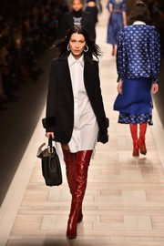 Red thigh-high boots added a welcome pop of color.