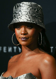 Rihanna swiped on some dark metallic lipstick to match her hat.