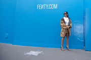 Rihanna looked cool in a camel-colored utility jacket and a matching mini skirt at the Fenty exclusive preview.